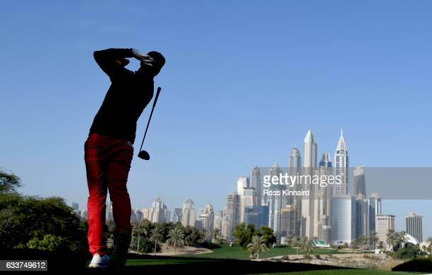 Zane Scotland of England on the par four 8th tee during the continuation of the weather delayed second round of the Omega Dubai Desert Classic at...