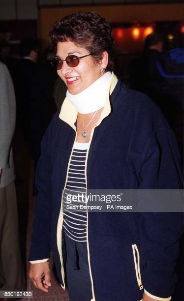 Zanela Loftus 52 from London arrives back at Heathrow wearing a surgical collar after violent turbulence turned her British Airways Boeing 747 into a...
