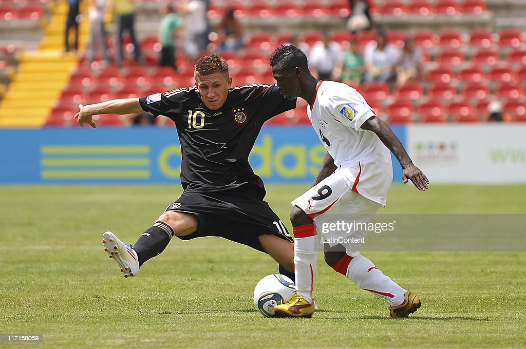 Zaniou Sana (R) of Burkina Faso struggles for the ball with Leveny Aycicek (L) of Germany during the FIFA U-17 World Cup Mexico 2011 Group E match between Burkina Faso and Germany at the Corregidora Stadium on June 23, 2011 in Queretaro, Mexico.