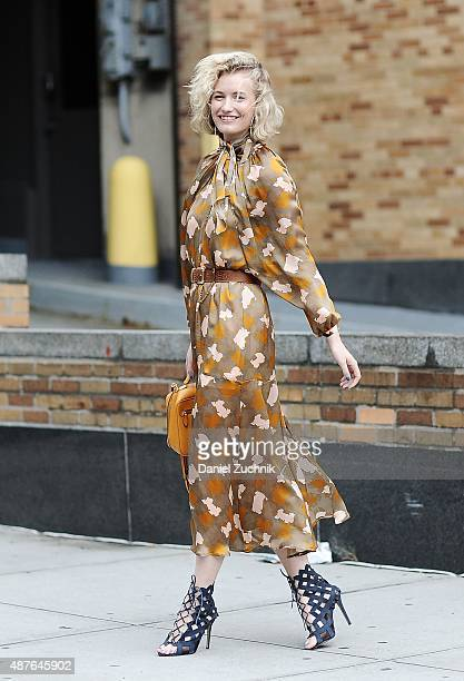 Zanita Whittington is seen outside the Josie Natori show wearing a Rodebjer dress with a Mark Cross orange bag during New York Fashion Week Spring...