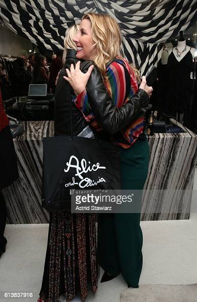 Zanna Roberts Rassi greets Sara Blakely as Blakely and Alice Olivia celebrate the launch of 'The Belly Art Project' on October 10 2016 in New York...