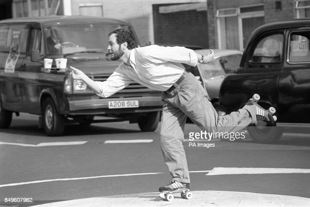 Zany TV comic Kenny Everett makes his debut on roller skates in London today while he delivers coffee for a spoof TV commercial Kenny was preparing...