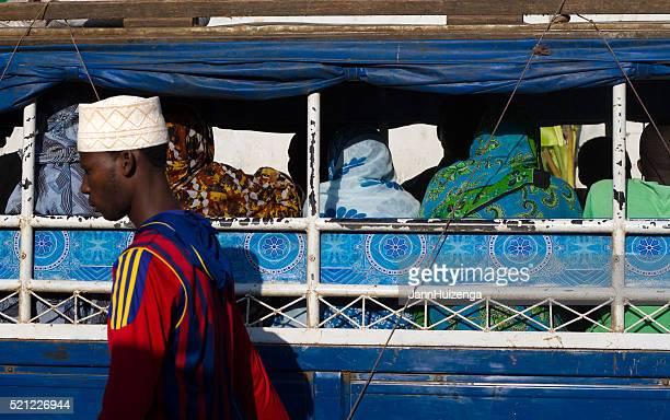 Zanzibar: Women in Hijab on Open Bus, Man in Skullcap