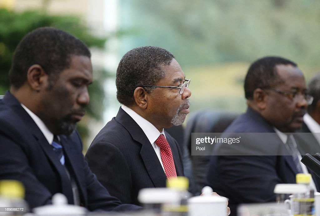 Zanzibar's President Ali Mohamed Shein (C) attends a meeting with China's President Xi Jinping (not pictured) at the Great Hall of the People on May 28, 2013 in Beijing, China.