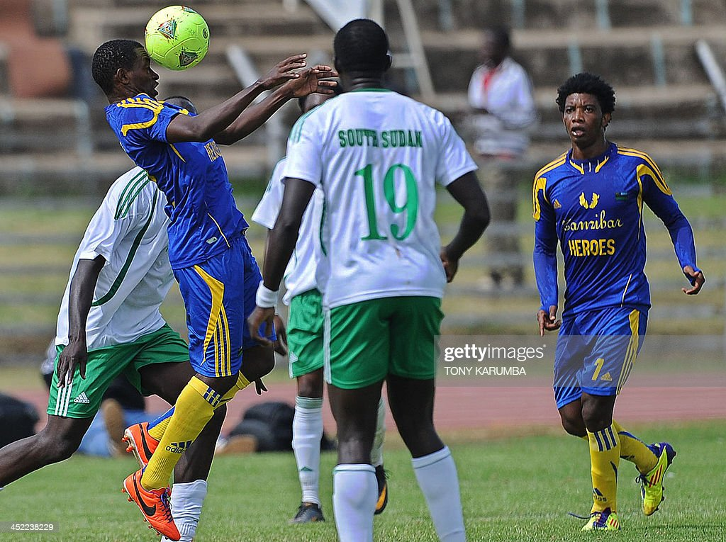Zanzibar's Wazirsalum Omar (L) heads the ball as he vies with south Sudan opponents next to teammate Suleiman Kassim (R) during the Council for East and Central Africa Football Associations (CECAFA) Cup football match Zanzibar vs South Sudan on November 27, 2013 in Nairobi. AFP PHOTO/Tony KARUMBA