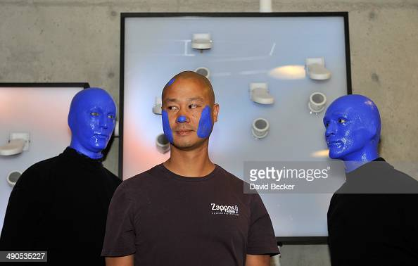 Zapposcom CEO Tony Hsieh and members of Blue Man Group appear during the unveiling of the 'ShoeZaphone' at Zappos headquaters on May 14 2014 in Las...