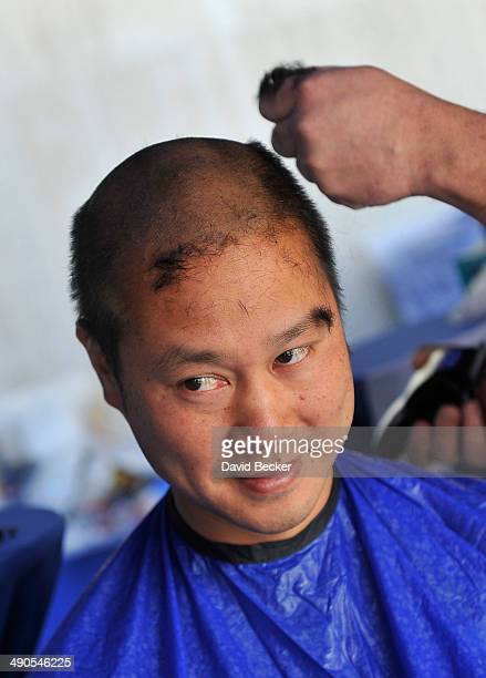 Zapposcom CEO Tony Hsieh has his head shaved before the unveiling of the 'ShoeZaphone' during the annual Bald and Blue fundraiser at Zappos...