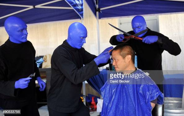 Zapposcom CEO Tony Hsieh pretends to have his head cut by members of Blue Man Group before the unveiling of the 'ShoeZaphone' during the annual Bald...