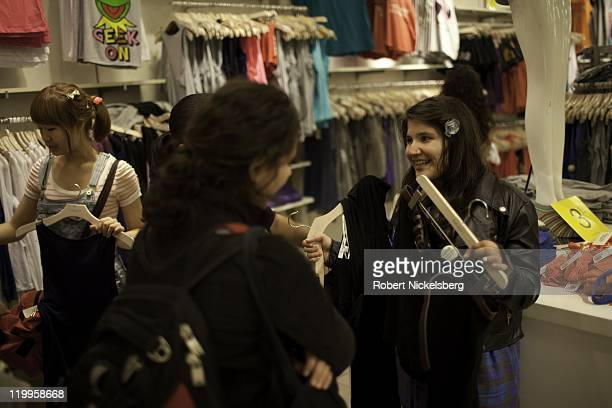 Zara Afridi right 18 years shops for clothing with friends at Forever 21 May 7 2011 in the Queens borough of New York Zara a PakistaniAmerican Muslim...