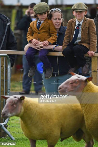 Zara Ailsa and Alfie Teasdalelook on as farmers show their sheep at the Royal Highland show on June 23 2017 in Edinburgh ScotlandThe Royal Highland...