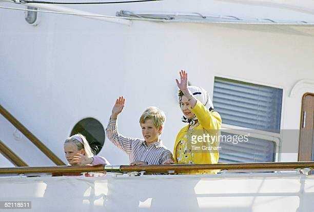 Zara And Peter Phillips And Their Grandmother The Queen Waving From The Royal Yacht Britannia On The Start Of A Western Isles Cruise