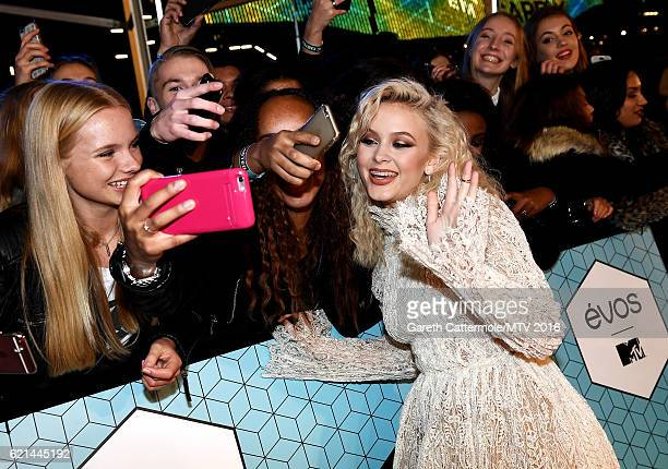Zara Larsson poses for a selfie with fans as she attends the MTV Europe Music Awards 2016 on November 6 2016 in Rotterdam Netherlands