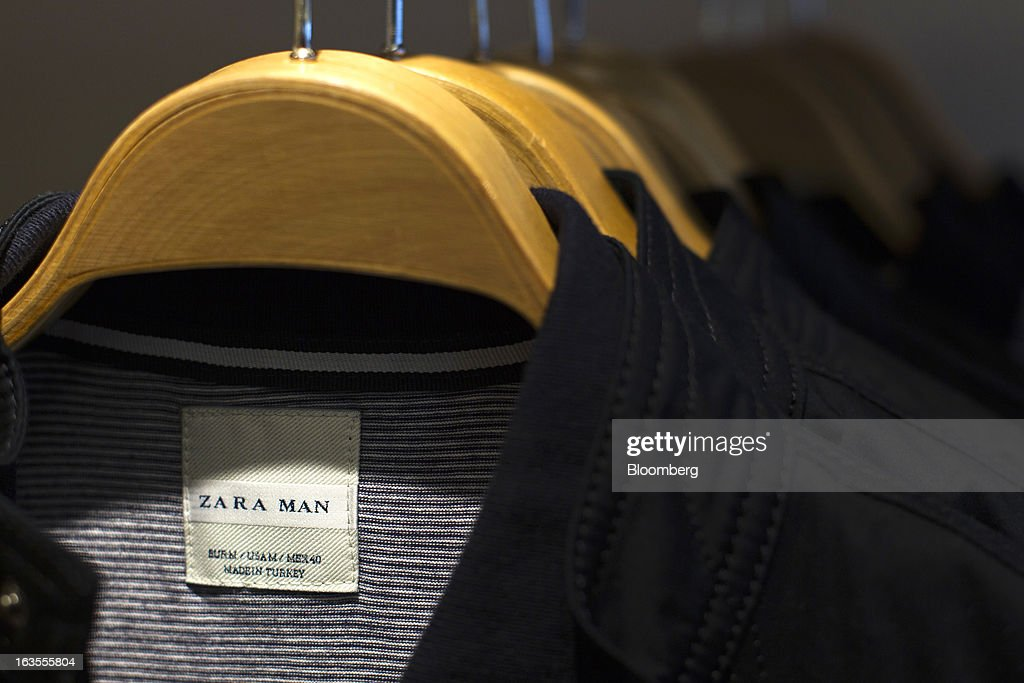 A 'Zara Man' logo is displayed on a clothing label inside a Zara fashion store, operated by Inditex SA, in Madrid, Spain, on Tuesday, March 12, 2013. Europe's richest man, Amancio Ortega, the 76-year-old founder of Inditex SA, the world's biggest clothing retailer and owner of the Zara clothing chain, is No. 3 on Standard & Poor's 500 Index with a net worth of $57.4 billion, $4.9 billion ahead of Warren Buffett, 82. Photographer: Angel Navarrete/Bloomberg via Getty Images