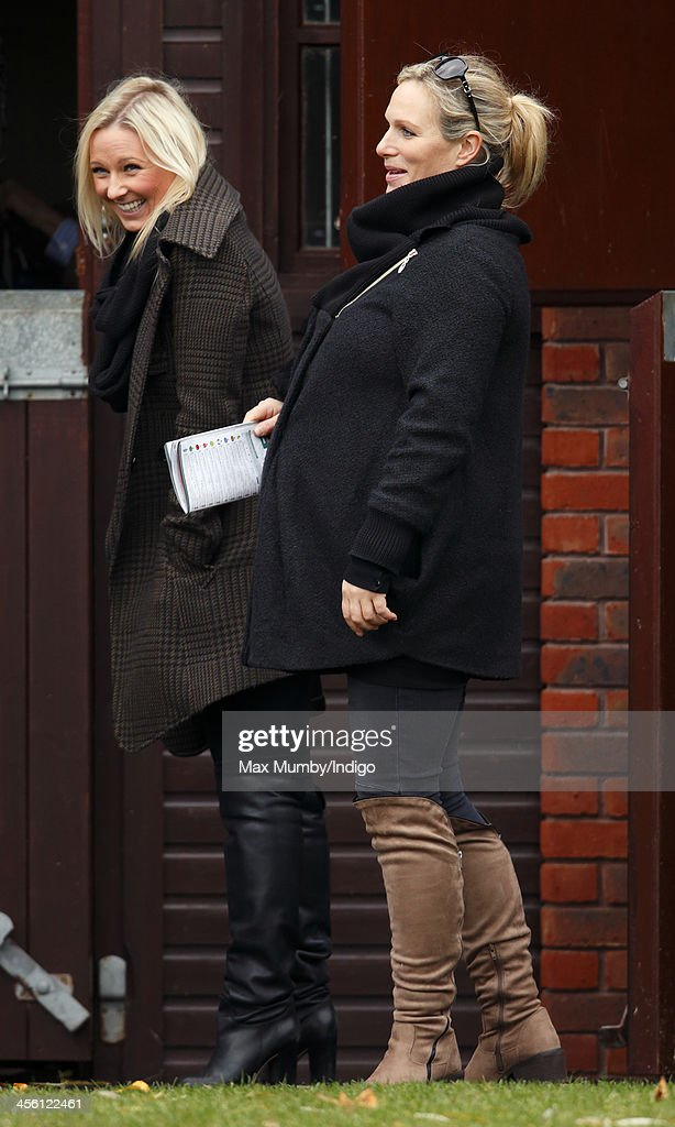 Zara Phillips accompanied by husband Mike Tindall attends The International meeting at Cheltenham Racecourse on December 13, 2013 in Cheltenham, England.