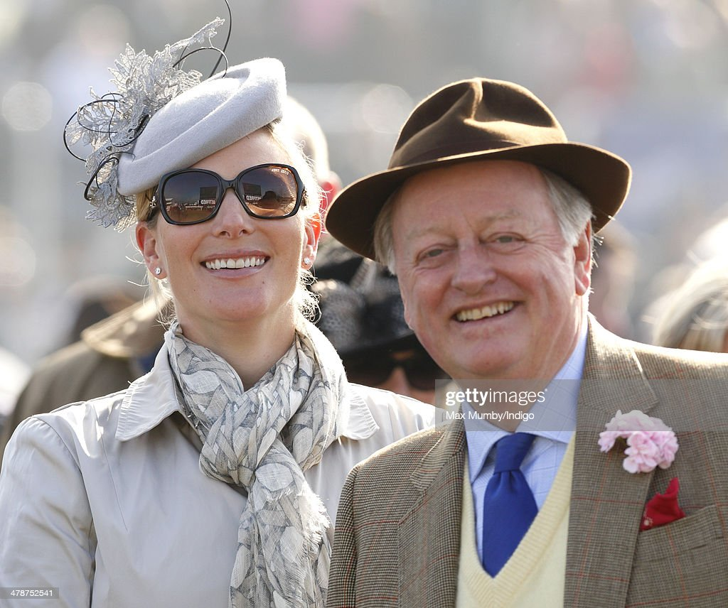 Zara Phillips and Andrew Parker Bowles watch the racing as they attend Day 4 of the Cheltenham Festival at Cheltenham Racecourse on March 14, 2014 in Cheltenham, England.