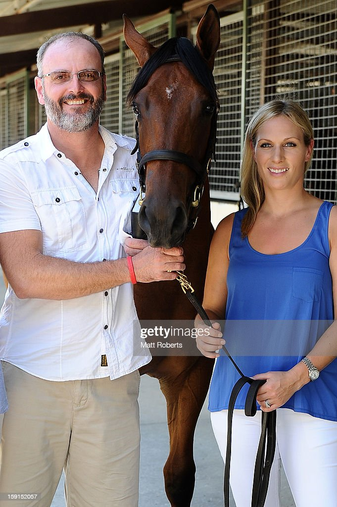 <a gi-track='captionPersonalityLinkClicked' href=/galleries/search?phrase=Zara+Phillips&family=editorial&specificpeople=161323 ng-click='$event.stopPropagation()'>Zara Phillips</a> and David Henderson pose for a photo at the Magic Millions Sales Complex on January 9, 2013 on the Gold Coast, Australia. <a gi-track='captionPersonalityLinkClicked' href=/galleries/search?phrase=Zara+Phillips&family=editorial&specificpeople=161323 ng-click='$event.stopPropagation()'>Zara Phillips</a> is the ambassador for the 2013 Magic Millions carnival.