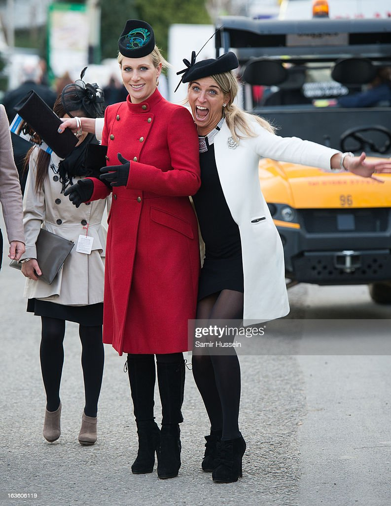 <a gi-track='captionPersonalityLinkClicked' href=/galleries/search?phrase=Zara+Phillips&family=editorial&specificpeople=161323 ng-click='$event.stopPropagation()'>Zara Phillips</a> (L) and friends attend the Cheltenham Festival Day 2 on Ladies Day at Cheltenham racecourse on March 13, 2013 in London, England.