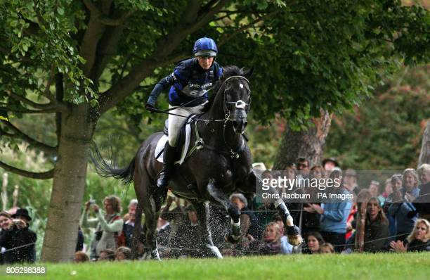 Zara Phillips and Glenbuck ride through the Trout Hatchery as they compete in the Cross Country event during day three of the Burghley Horse Trials...