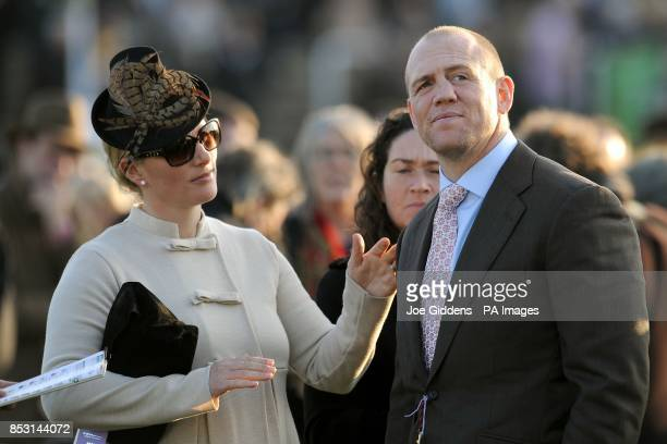 Zara Phillips and her husband Mike Tindall watch the Terry Biddlecombe National Hunt Chase during Champion Day at Cheltenham Racecourse Cheltenham