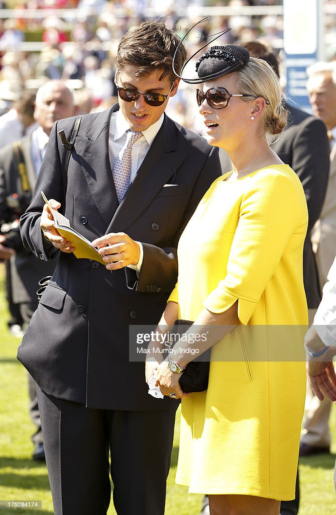 Zara Phillips and Jake Warren attend Ladies Day of Glorious Goodwood at Goodwood Racecourse on August 1, 2013 in Chichester, England.