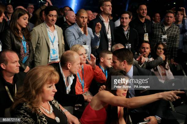 Zara Phillips and Mike Tindall in their seats before the the IBF and WBA World Super Middleweight Title fight between Carl Froch and George Groves at...