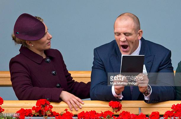 Zara Phillips and Mike Tindall watch Frankel enter the winners enclosure after winning The QIPCO Champion Stakes as they attend the QIPCO British...