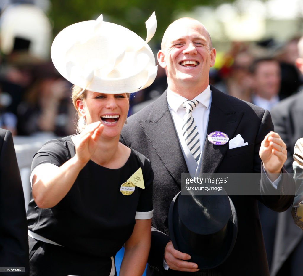 <a gi-track='captionPersonalityLinkClicked' href=/galleries/search?phrase=Zara+Phillips&family=editorial&specificpeople=161323 ng-click='$event.stopPropagation()'>Zara Phillips</a> and <a gi-track='captionPersonalityLinkClicked' href=/galleries/search?phrase=Mike+Tindall&family=editorial&specificpeople=204210 ng-click='$event.stopPropagation()'>Mike Tindall</a> wave to Queen <a gi-track='captionPersonalityLinkClicked' href=/galleries/search?phrase=Elizabeth+II&family=editorial&specificpeople=67226 ng-click='$event.stopPropagation()'>Elizabeth II</a> and other members of The Royal Family in the carriage procession as they attend Day 1 of Royal Ascot at Ascot Racecourse on June 17, 2014 in Ascot, England.