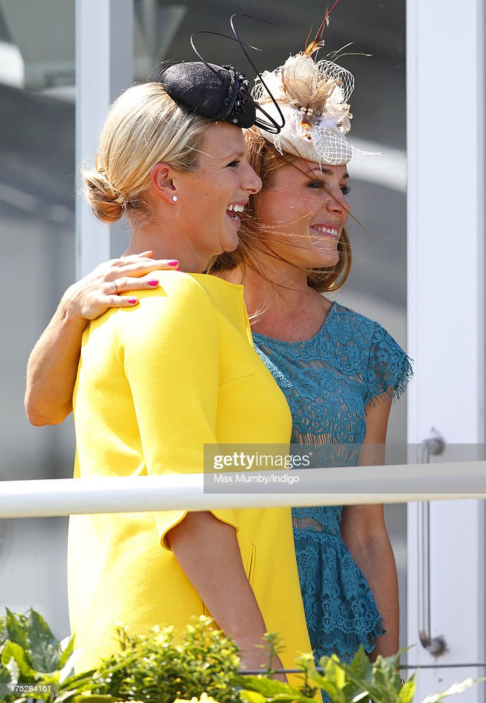 Zara Phillips and Natalie Pinkham attend Ladies Day of Glorious Goodwood at Goodwood Racecourse on August 1, 2013 in Chichester, England.