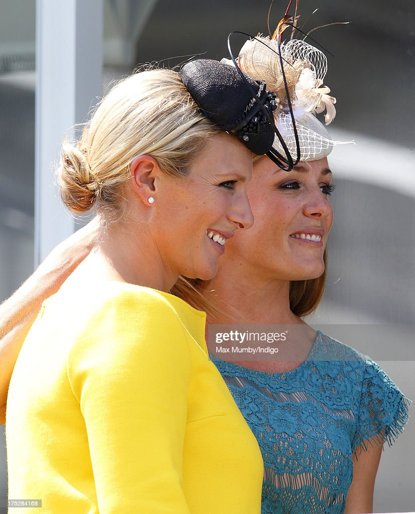 <a gi-track='captionPersonalityLinkClicked' href=/galleries/search?phrase=Zara+Phillips&family=editorial&specificpeople=161323 ng-click='$event.stopPropagation()'>Zara Phillips</a> and <a gi-track='captionPersonalityLinkClicked' href=/galleries/search?phrase=Natalie+Pinkham&family=editorial&specificpeople=2445880 ng-click='$event.stopPropagation()'>Natalie Pinkham</a> attend Ladies Day of Glorious Goodwood at Goodwood Racecourse on August 1, 2013 in Chichester, England.