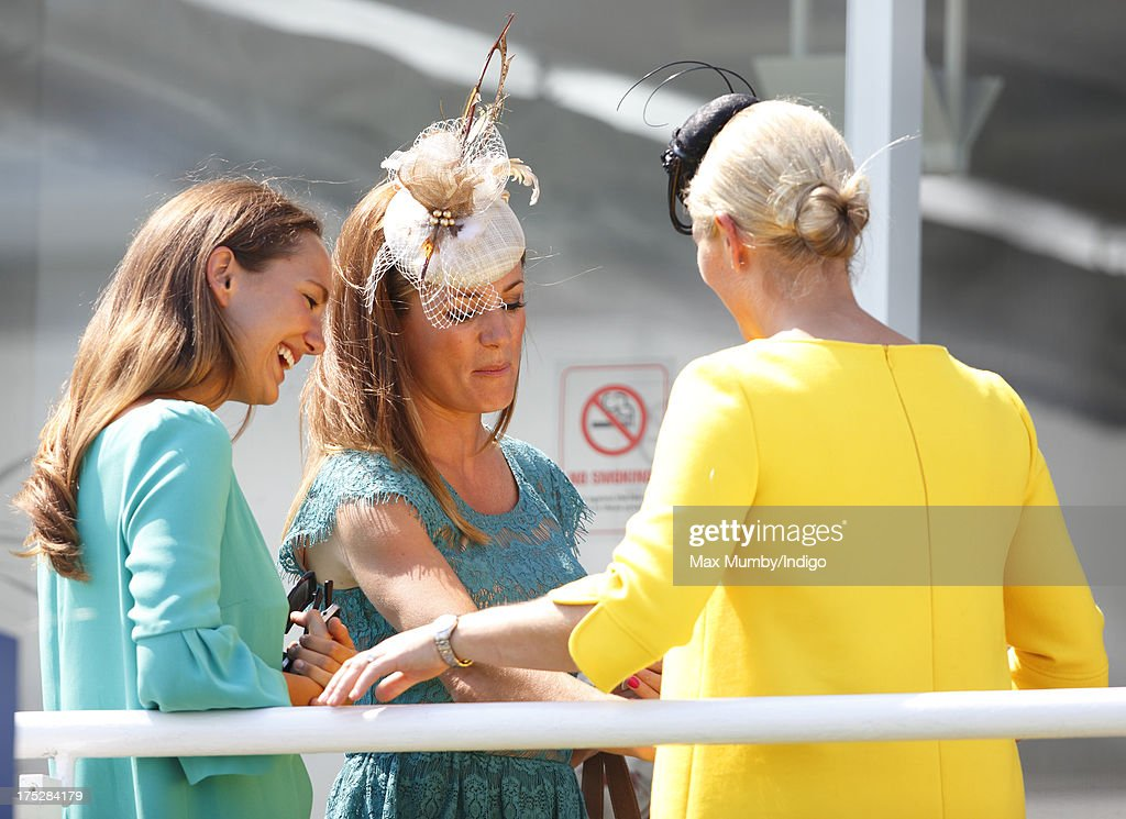 Zara Phillips and Natalie Pinkham (c) attend Ladies Day of Glorious Goodwood at Goodwood Racecourse on August 1, 2013 in Chichester, England.