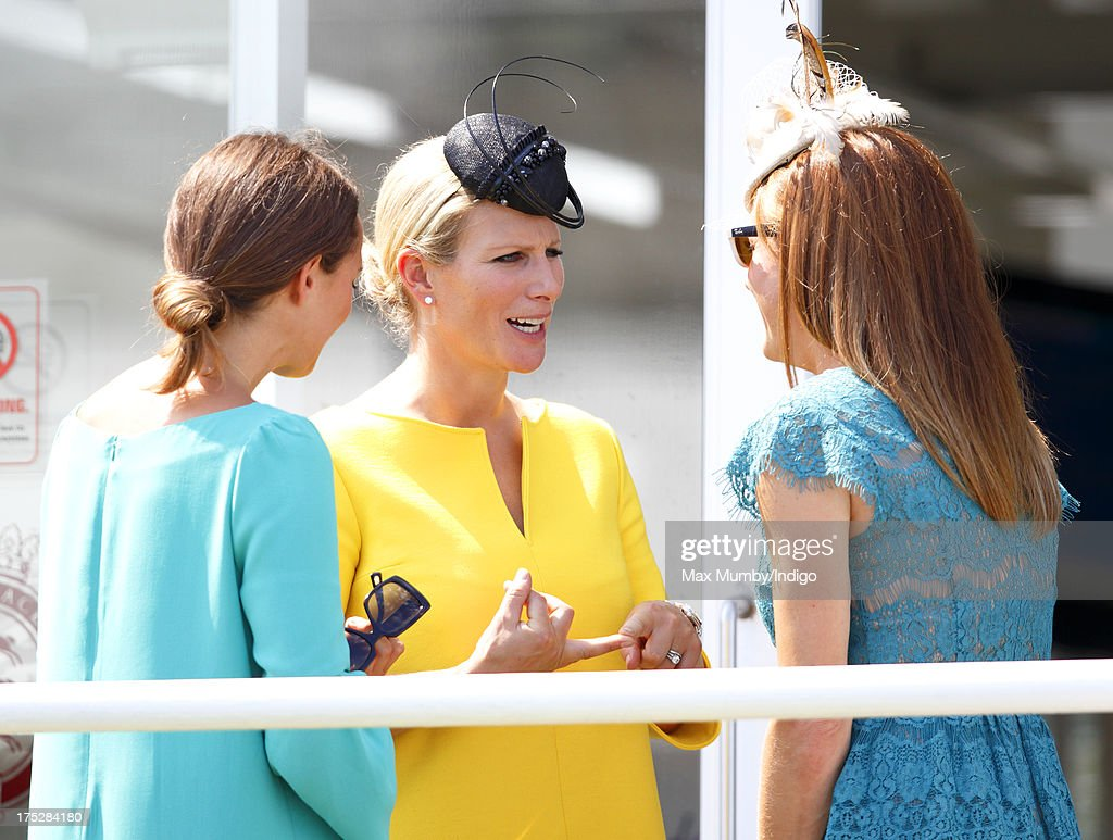 Zara Phillips and Natalie Pinkham (r) attend Ladies Day of Glorious Goodwood at Goodwood Racecourse on August 1, 2013 in Chichester, England.