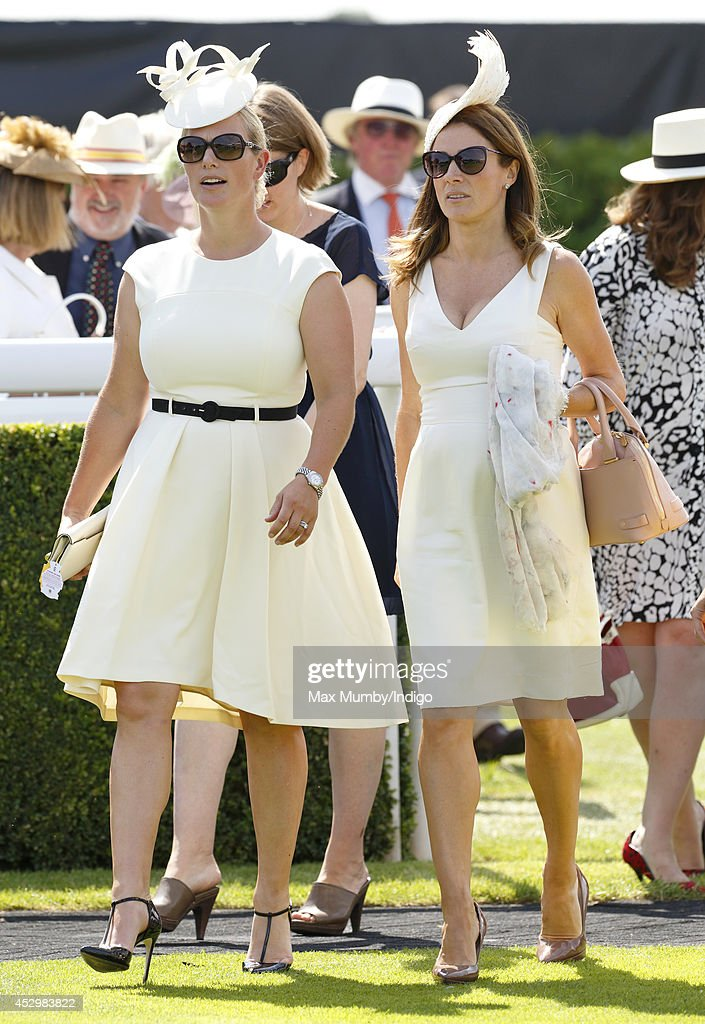<a gi-track='captionPersonalityLinkClicked' href=/galleries/search?phrase=Zara+Phillips&family=editorial&specificpeople=161323 ng-click='$event.stopPropagation()'>Zara Phillips</a> and <a gi-track='captionPersonalityLinkClicked' href=/galleries/search?phrase=Natalie+Pinkham&family=editorial&specificpeople=2445880 ng-click='$event.stopPropagation()'>Natalie Pinkham</a> attend Ladies Day of Glorious Goodwood at Goodwood Racecourse on July 31, 2014 in Chichester, England.