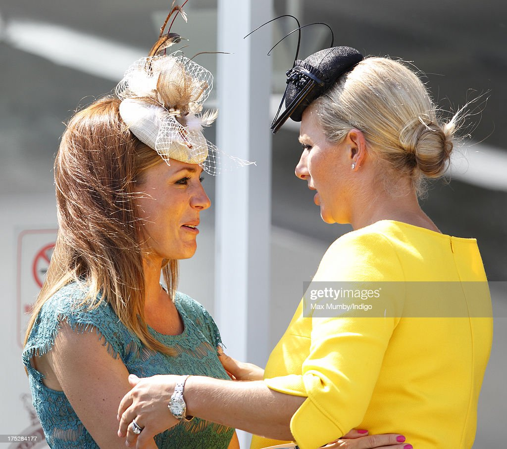 Zara Phillips and Natalie Pinkham hug as they attend Ladies Day of Glorious Goodwood at Goodwood Racecourse on August 1, 2013 in Chichester, England.