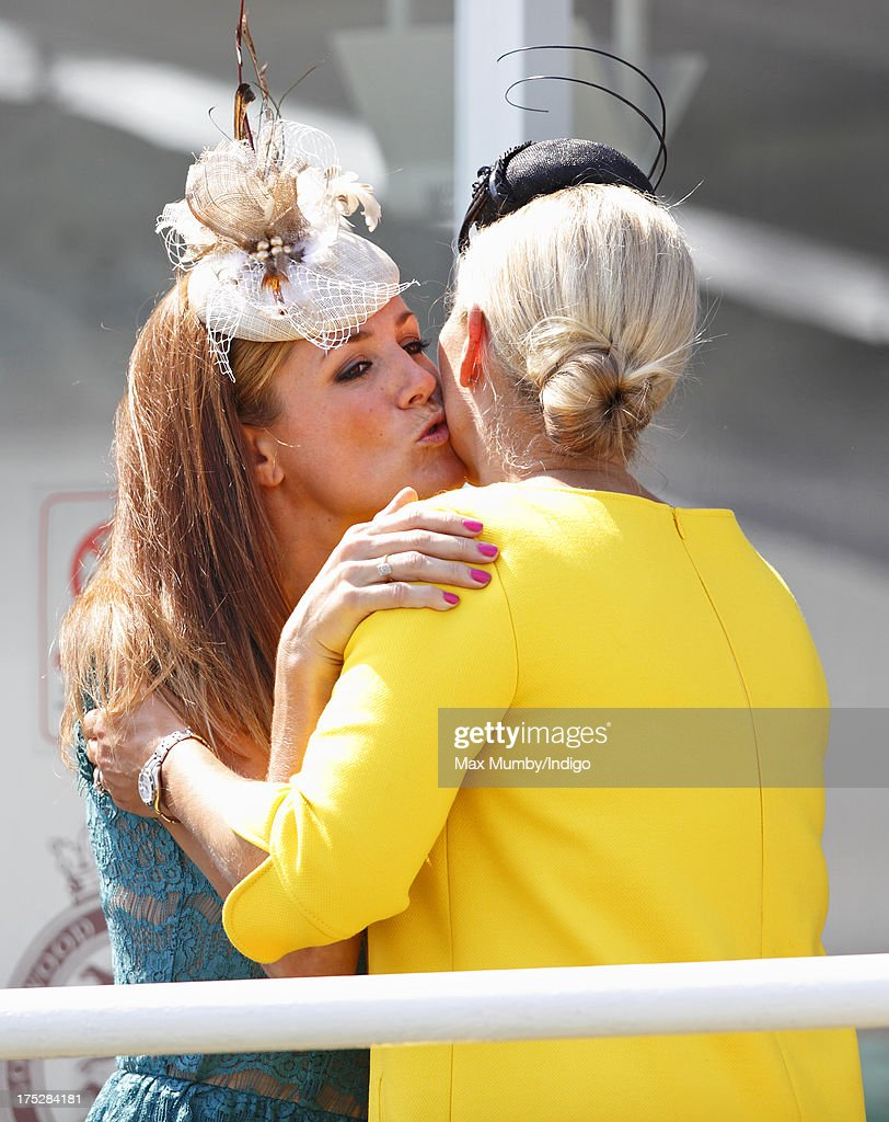 Zara Phillips and Natalie Pinkham kiss as they attend Ladies Day of Glorious Goodwood at Goodwood Racecourse on August 1, 2013 in Chichester, England.