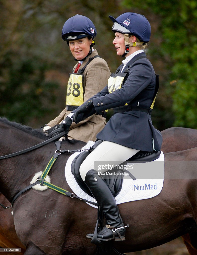<a gi-track='captionPersonalityLinkClicked' href=/galleries/search?phrase=Zara+Phillips&family=editorial&specificpeople=161323 ng-click='$event.stopPropagation()'>Zara Phillips</a> (R) and <a gi-track='captionPersonalityLinkClicked' href=/galleries/search?phrase=Pippa+Funnell&family=editorial&specificpeople=243030 ng-click='$event.stopPropagation()'>Pippa Funnell</a> ride alongside each other in a break from competing in the Tweseldown Horse Trials at Tweseldown Racecourse on March 9, 2012 in Fleet, England.