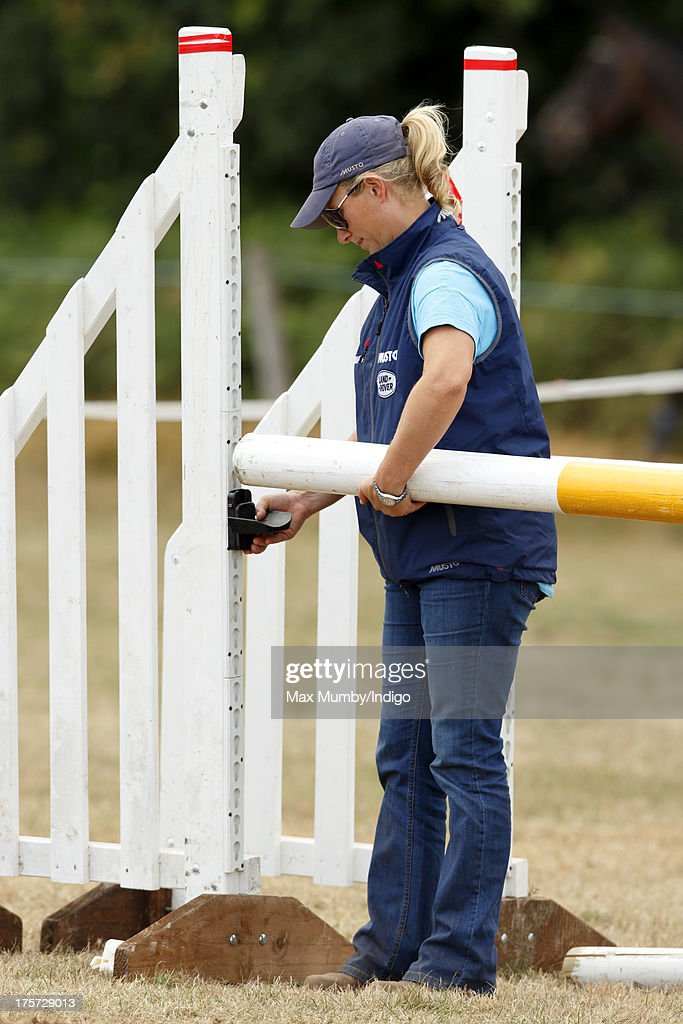 Zara Phillips assembles a show jump as she coaches rider Aimee Aspinall, who is competing on several of Zara's horses at the Smiths Lawn Horse Trials on August 5, 2013 in Windsor, England.