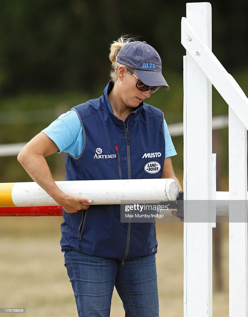 <a gi-track='captionPersonalityLinkClicked' href=/galleries/search?phrase=Zara+Phillips&family=editorial&specificpeople=161323 ng-click='$event.stopPropagation()'>Zara Phillips</a> assembles a show jump as she coaches rider Aimee Aspinall, who is competing on several of Zara's horses at the Smiths Lawn Horse Trials on August 5, 2013 in Windsor, England.