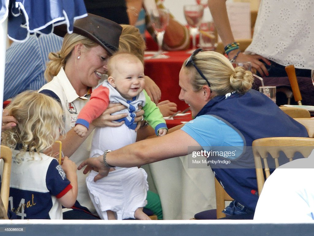 <a gi-track='captionPersonalityLinkClicked' href=/galleries/search?phrase=Zara+Phillips&family=editorial&specificpeople=161323 ng-click='$event.stopPropagation()'>Zara Phillips</a>, assisted by <a gi-track='captionPersonalityLinkClicked' href=/galleries/search?phrase=Autumn+Phillips&family=editorial&specificpeople=728048 ng-click='$event.stopPropagation()'>Autumn Phillips</a> (left), changes her daughter <a gi-track='captionPersonalityLinkClicked' href=/galleries/search?phrase=Mia+Tindall&family=editorial&specificpeople=12480820 ng-click='$event.stopPropagation()'>Mia Tindall</a>'s clothes as they attend day 2 of the Festival of British Eventing at Gatcombe Park on August 2, 2014 in Minchinhampton, England.