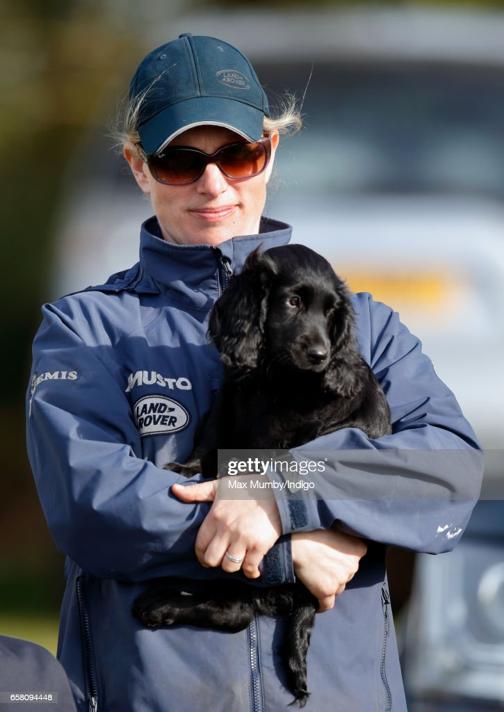 Zara Phillips carries a puppy as she attends the Gatcombe Horse Trials at Gatcombe Park on March 26, 2017 in Stroud, England.