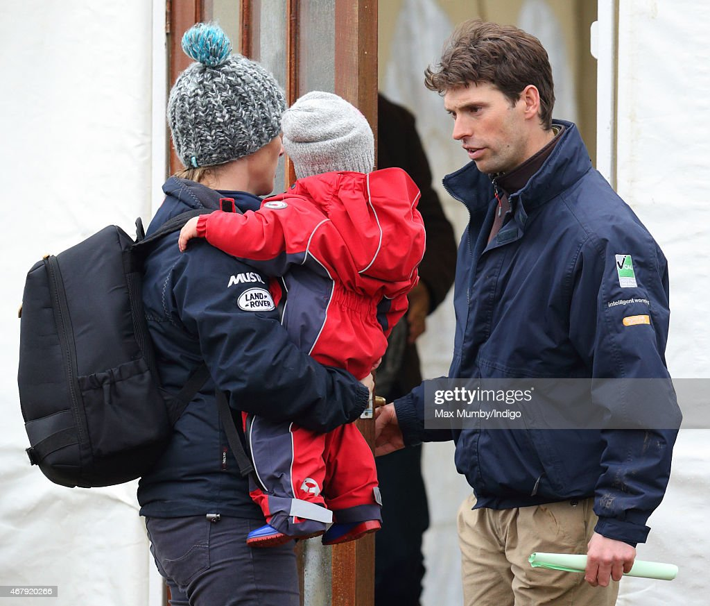 <a gi-track='captionPersonalityLinkClicked' href=/galleries/search?phrase=Zara+Phillips&family=editorial&specificpeople=161323 ng-click='$event.stopPropagation()'>Zara Phillips</a> carries daughter Mia Tindall as she and <a gi-track='captionPersonalityLinkClicked' href=/galleries/search?phrase=Harry+Meade&family=editorial&specificpeople=2264034 ng-click='$event.stopPropagation()'>Harry Meade</a> (right) attend the Gatcombe Horse Trials at Gatcombe Park on March 28, 2015 in Stroud, England.