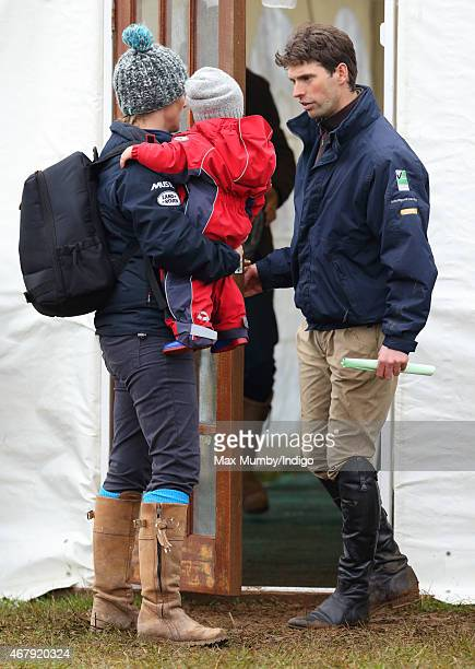Zara Phillips carries daughter Mia Tindall as she and Harry Meade attend the Gatcombe Horse Trials at Gatcombe Park on March 28 2015 in Stroud England