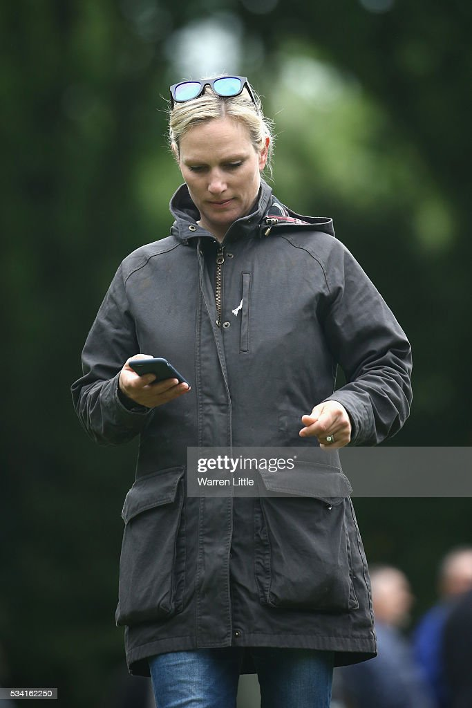 <a gi-track='captionPersonalityLinkClicked' href=/galleries/search?phrase=Zara+Phillips&family=editorial&specificpeople=161323 ng-click='$event.stopPropagation()'>Zara Phillips</a> checks her phone during the Pro-Am prior to the BMW PGA Championship at Wentworth on May 25, 2016 in Virginia Water, England.
