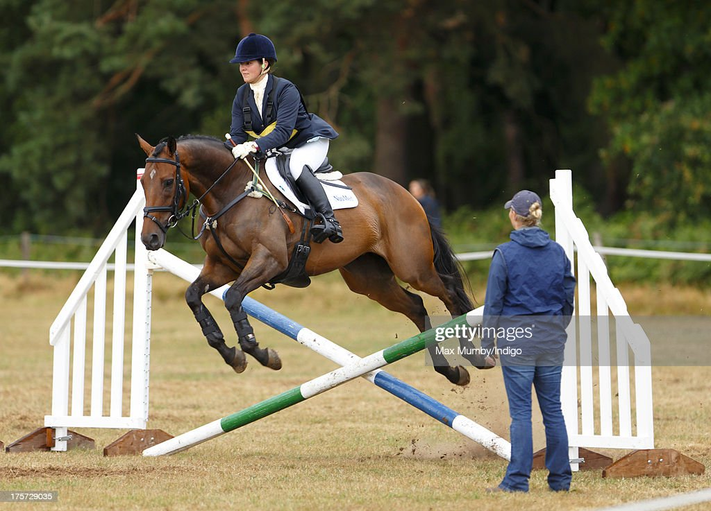 <a gi-track='captionPersonalityLinkClicked' href=/galleries/search?phrase=Zara+Phillips&family=editorial&specificpeople=161323 ng-click='$event.stopPropagation()'>Zara Phillips</a> coaches rider Aimee Aspinall, who is competing on several of Zara's horses at the Smiths Lawn Horse Trials on August 5, 2013 in Windsor, England.