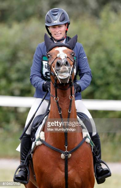 Zara Phillips competes on her horse 'Drops of Brandy' in the showjumping phase of the Barbury International Horse Trials on July 7 2017 in...