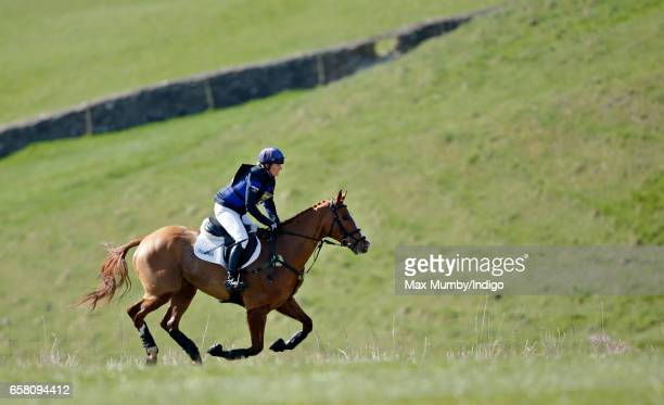 Zara Phillips competes on her horse 'Fernhill FaceTime' in the cross country phase of the Gatcombe Horse Trials at Gatcombe Park on March 26 2017 in...