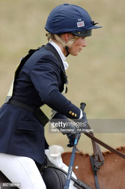 Zara Phillips concentrates during the show jumping at the Festival of British Eventing at Gatcombe Park