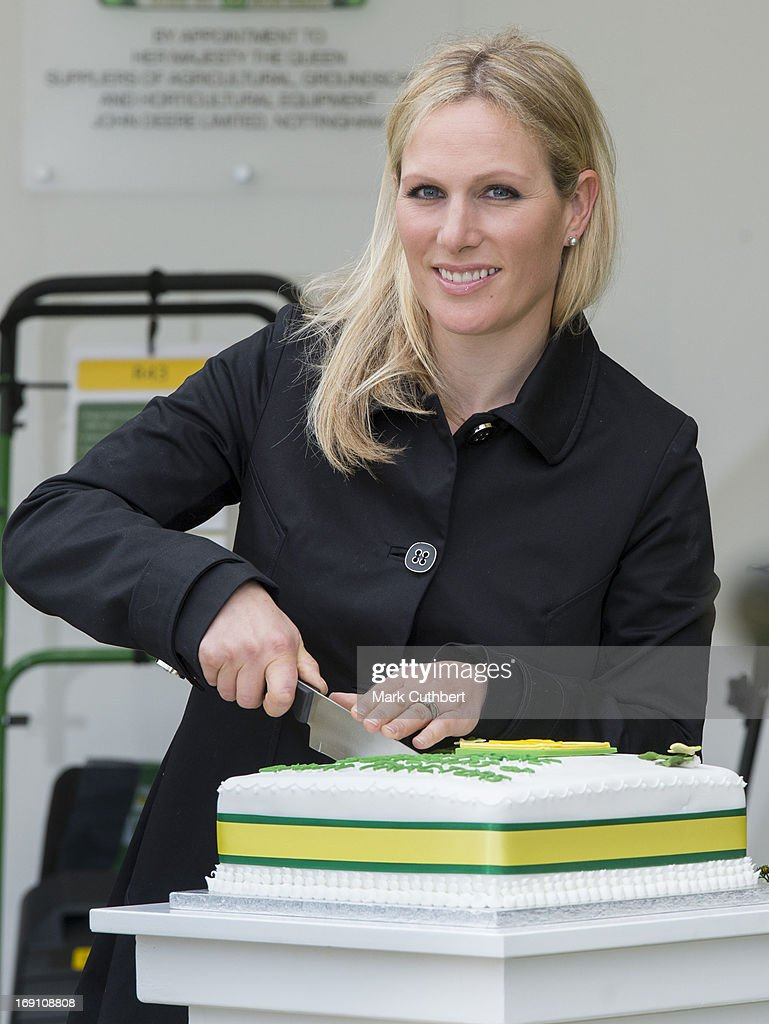Zara Phillips cuts a cake to mark 50 years of John Deere products as she attends the Chelsea Flower Show press and VIP preview day at Royal Hospital Chelsea on May 20, 2013 in London, England.