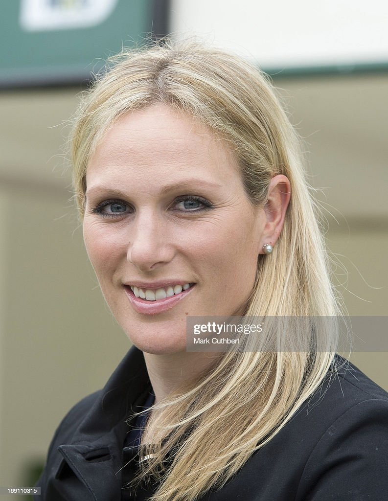Zara Phillips cuts a cake to mark 50 yrs of John Deere products as she attends the Chelsea Flower Show press and VIP preview day at Royal Hospital Chelsea on May 20, 2013 in London, England.