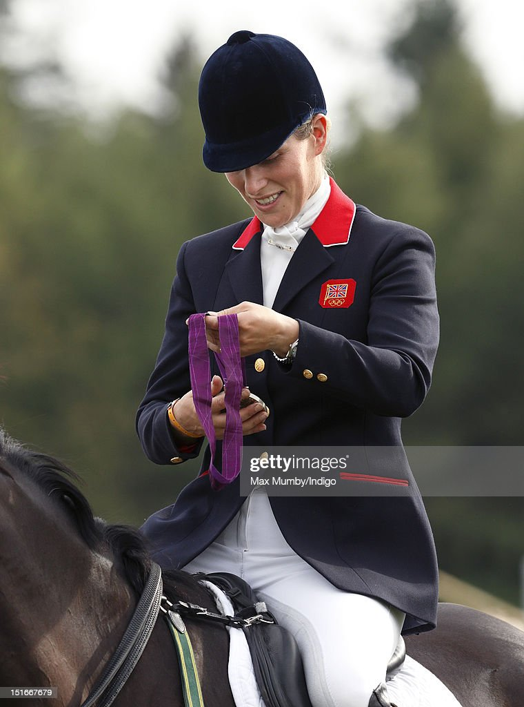 Zara Phillips holds her London 2012 Olympic silver medal before she and her fellow team eventing medal winners parade at the Blenheim Palace International Horse Trials on September 9, 2012 in Woodstock, England.