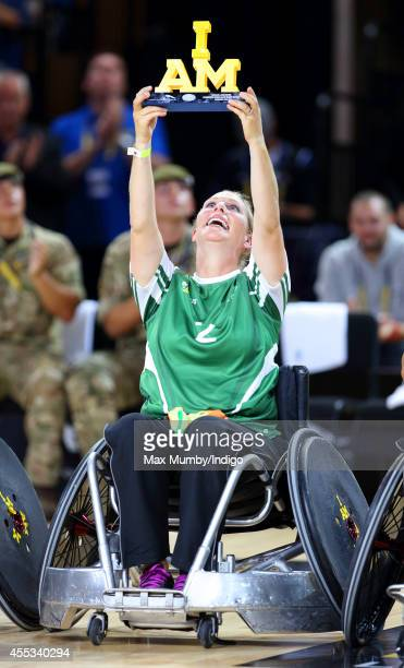 Zara Phillips holds the 'I am' trophy aloft after winning a Wheelchair Rugby exhibition match in the Copper Box Arena during the Invictus Games on...